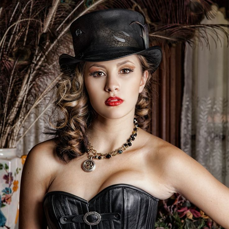 A beautiful hat was worn by another beauty. She knows how to look sexy.
