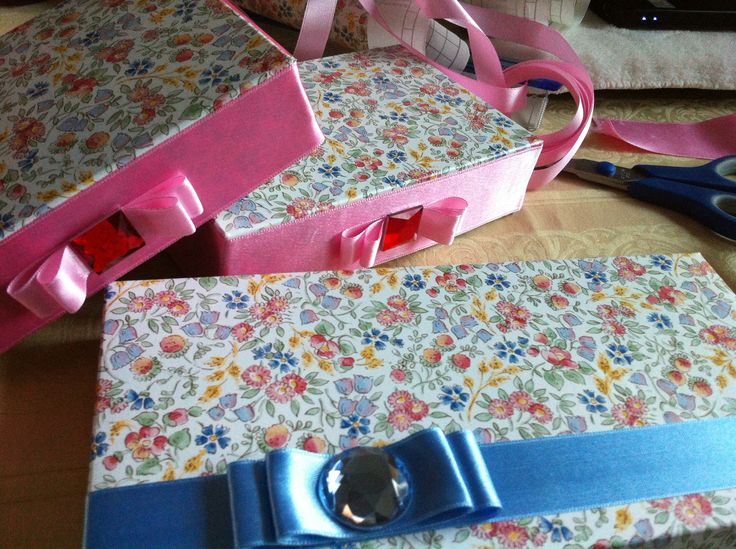 dull box, made attractive. All you need is paper, little ribbon and a rhinestone