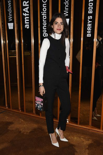 Leandra has cracked the code for holiday dressing with a piecemealed tux cum jumpsuit of sorts, thanks to some black trousers, a turtleneck, and the lovely pairing of black and white. DOING THIS.