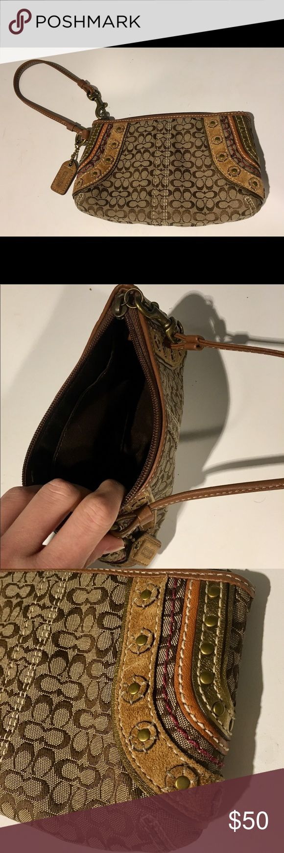 Coach Wristlet Authentic coach Wristlet. Brown fabric with side details including grommets and goals leather. Slightly edgy, perfect amount of detail. Great for a night out! Coach Bags Clutches & Wristlets