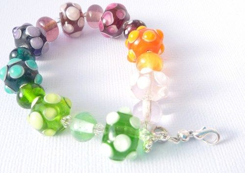 Lampwork Glass Bracelet in Transparent Rainbow colours with raised tra