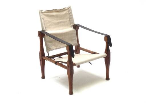 Designer, possibly Danish mid century safari chair. Canvas and leather. Very nice indeed.  #safarichair #mcm #modernism #danishmodern