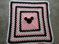Mickey Mouse and Minnie Mouse Crochet Blanket Pattern. The pattern includes instructions on how to make BOTH Mickey Mouse AND Minne Mouse Blankets.  Wouldnt this be adorable in your stroller at Disney?  The pattern is suitable for a girl or boy. This pattern is perfect for a beginner. Fun and easy to make. This blanket looks good on both sides. The fourth photo shows what the face looks like on the back side. You can choose to put the bow on both sides of the blanket if you like. I just…
