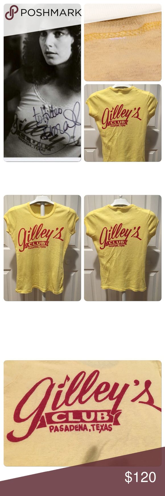 VINTAGE 70s GILLEYS Urban Cowboy Tee Super sweet classic Gilley's tee from Pasadena Texas. Popularized by the film Urban Cowboy, Gilley's was the place to go for the best in classic country music. This tee is the perfect ladies cut in a great apricot color with red lettering. Graphic on front and back. Sweet scoop neck and cap sleeves! Cut Label size small .. double sided print , thin 50-50 Poly cotton yellow tee. No holes stains rips or tears. Vintage Tops Tees - Short Sleeve