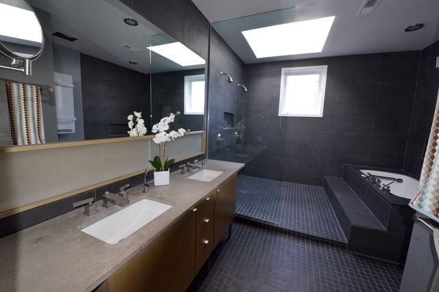 Sleek sun-filled bathroom with a wet room shower and bath | Wicker Park, Chicago, IL