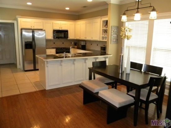 Baton Rouge Apartments  : Choose Your Location: Fascinating Baton Rouge Apartments With Cheap Kitchen Remodel Cost Using Kitchen Countertop Kitchen Sink Also Stainless Steel Refrigerator Along With Modern Dining Room Tables Also Flowery Vases Laminate Wood Floor ~ surrealcoding.com Apartments Inspiration