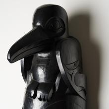 Stone Ribs bronze totem pole by Haida artist Gwaii Edenshaw