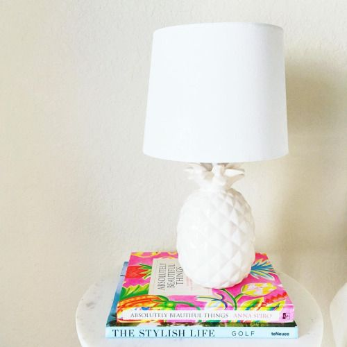 white marble coffee table and white pineapple lamp with white lamp shade