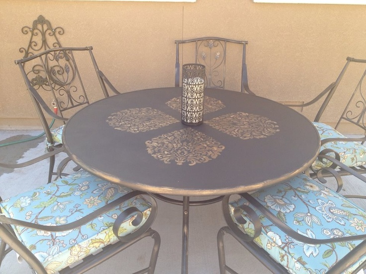 Glass patio table and chairs. $50 painted and stenciled the glass to look like an iron table! Love it :)