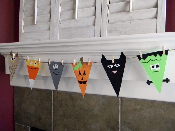 Halloween Craft Ideas--I think this would be cute to hang the string and then do these with the kids for each holiday and season (triangular turkeys, candy corn, etc. for Halloween, santas and reindeer for Christmas)