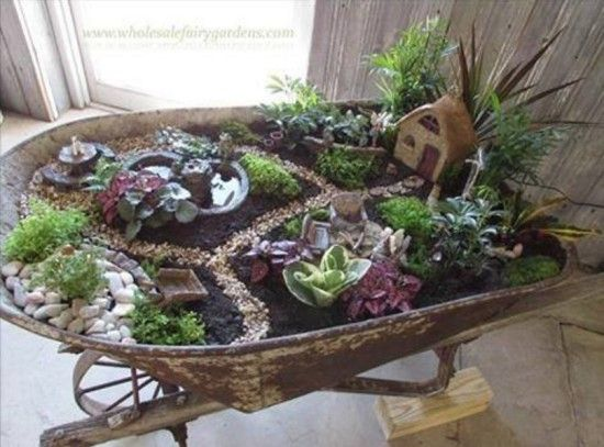 Wheelbarrow Fairy Garden - linked article also shows other fun containers for your fairy garden.