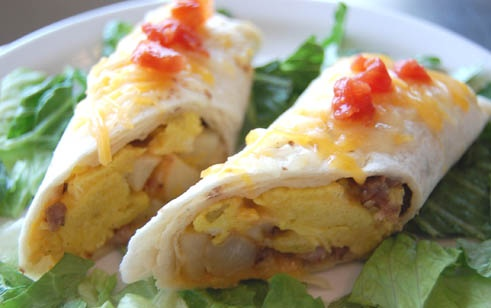 Easy breakfast burritos... Love the idea of wrapping them in parchment paper to freeze then reheat