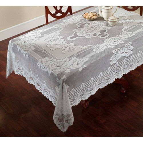 """Sharon Lace Tablecloth 60""""x120"""" WHITE by Lorraine Home Fashions. $14.29. 100% polysester fabric. Scalloped. Machine washable polyester. The Sharon Lace Tablecloth will add a touch of class to your kitchen or dining room. This exquisite tablecloth is made of 100% machine washable polyester and available in 2 colors: White or Cream (Beige). This heavy weight jacquard knitted lace tablecloth is engineered with a central floral medallion motif surrounded by a floral border and scallo..."""