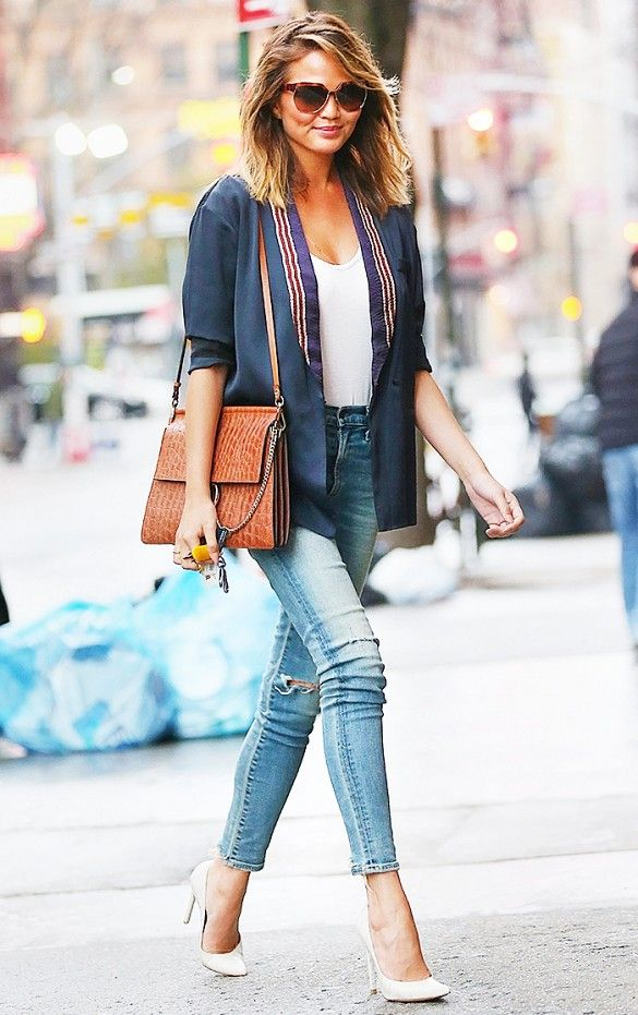 Chrissy Teigen in a chic blazer and skinny jeans combo
