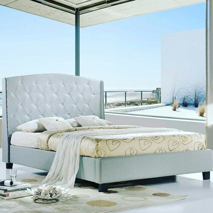 Neutral Hues And An Extra Tall Tufted Headboard W A