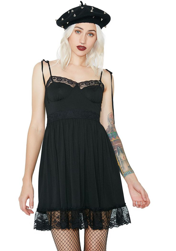 Sugar Thrillz Midnight Cutie Chaser Lacy Dress cuz we like our candy dark! This cute dress has a sweetheart neckline, lace trim, adjustable tie shoulder straps and invisible side zip closure.