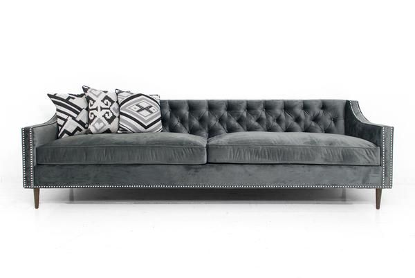 Add some warmth and elegance to your space with this cozy charcoal velvet tufted sofa, featuring a gentle sloping arm detail and custom walnut cone legs. 9' Lon