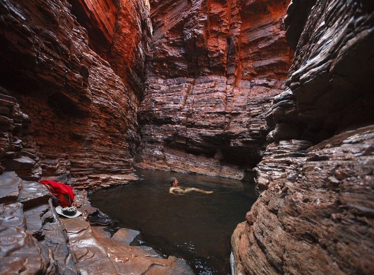 Man swimming water hole deep in gorge