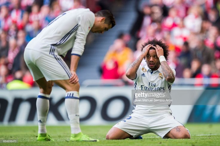 Marcelo Vieira da Silva an Cristiano Ronaldo of Real Madrid reacts during the La Liga match between Athletic Club Bilbao and Real Madrid at San Mames Stadium on March 18, 2017 in Bilbao, Spain.