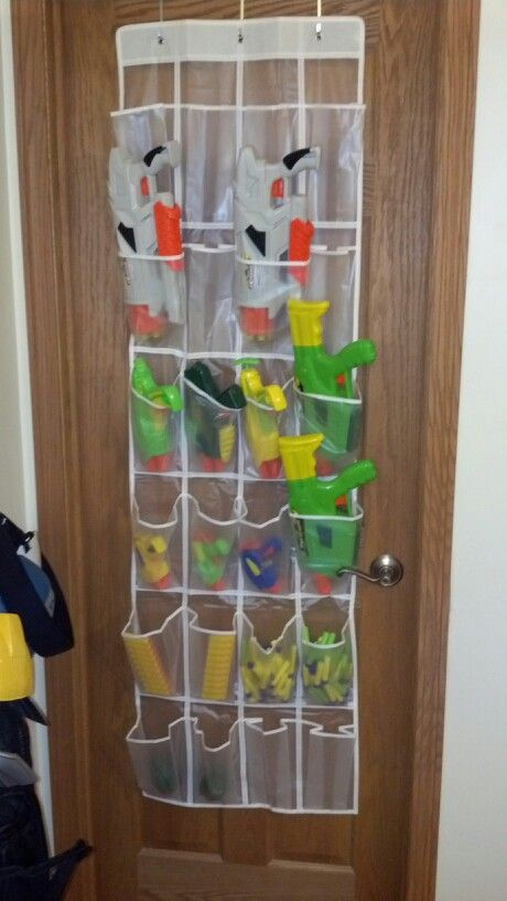 Passing on this idea I found for storing Nerf guns. Just need a plastic shoe storage bag or rack. My boys loved it!