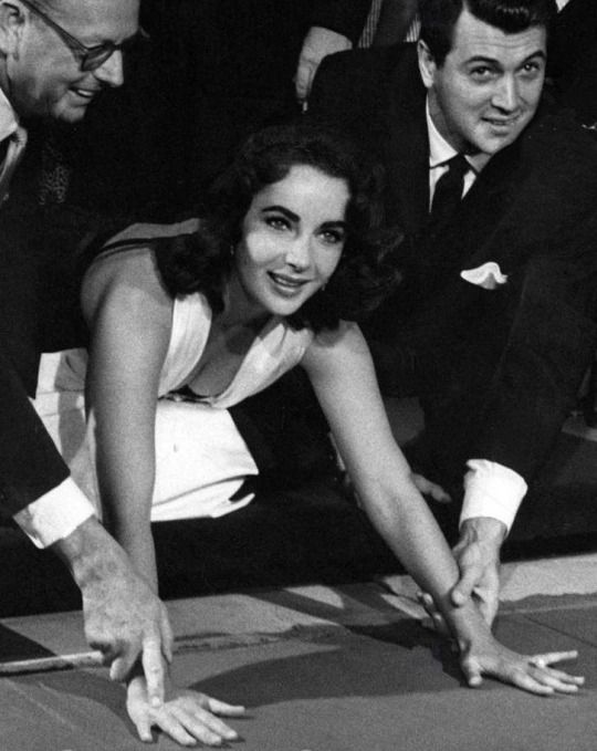 Elizabeth Taylor at the Chinese Theatre with Rock Hudson