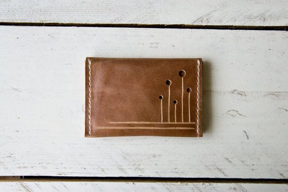 """This products is 100% handmade, hand chosen, hand cut, hand decorated and hand stitched.  Size: 7 x 10,5 cm/2.8"""" x 4.2"""" Material: genuine italian leather and italian waxed nylon thread. Colour: light brown  1 card slot with 2 bigger slots on both size. Designed to hold your credit cards, your currency, business cards and more. Hand-stiched using heavy italian nylon thread. High quality italian leather. Ideal for both men and women. $18"""