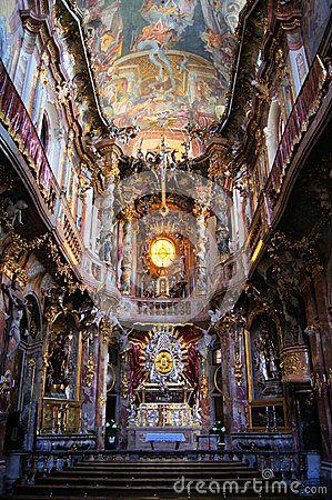 Ornate interior of the rococo Asam Church in Munich ...