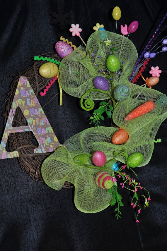 This Easter Wreath is made out of grapevine, deco mesh and egg and carrot glitter accent pieces