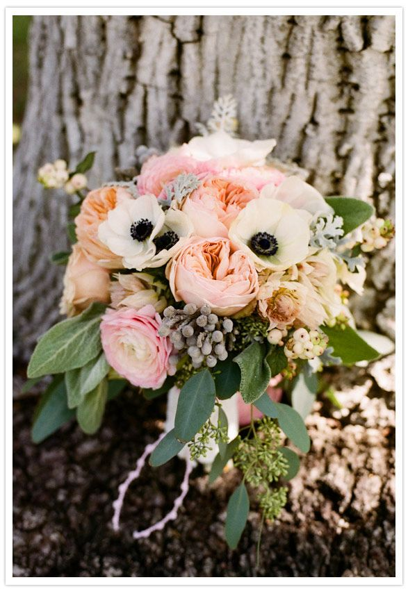 Honey and Poppies : The bridal bouquet was a big, lush arrangementthat includedgarden roses, black and white anemones anddinnerplate cafe au lait dahlias mingling withdusty millers and berzilia berries.
