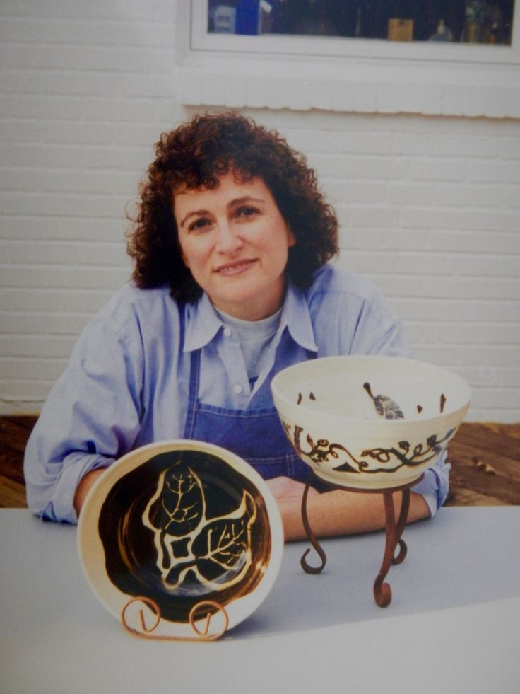 Actually, this is not a customer. That's me in 1998 or so with some slip-decorated and carved salad bowls.