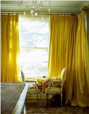love the floor to ceiling yellow curtains