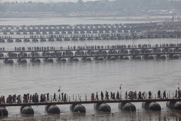 Allahabad, Uttar Pradesh, India. Allahabad, Uttar Pradesh, India: thousand of pilgrims walk on boat-bridges during the Maha Kumbh Mela, the biggest religious festival in India. In 2013 edition, more than 80 million people arrive here during the 55 days of celebrations.