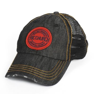 Eric Church Carolina Products design on an embroidered patch sewn on a denim trucker style baseball cap.