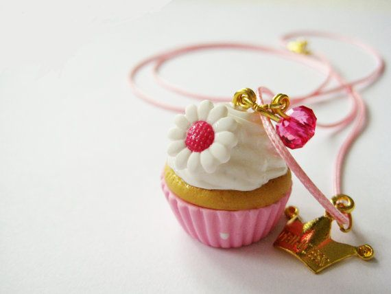 Handmade pink cupcake necklace with a pink plastic bead and a gold plated crown