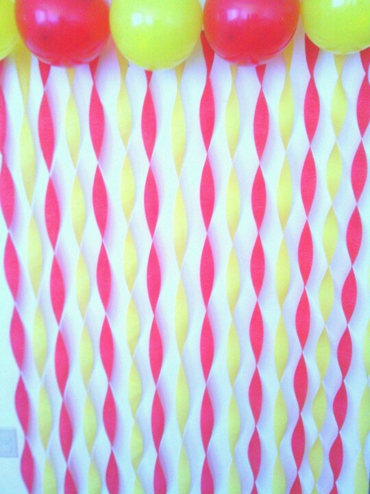 Our backdrop for pictures. Curious george colors. Red and yellow decor.