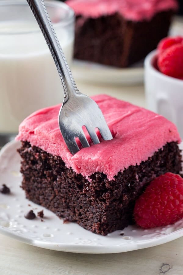 Chocolate Cake with Raspberry Frosting. This rich, super fudgy chocolate cake has a deep chocolate flavor. Then it's topped with fresh raspberry buttercream so it's perfect for Valentine's! www.justsotasty.com