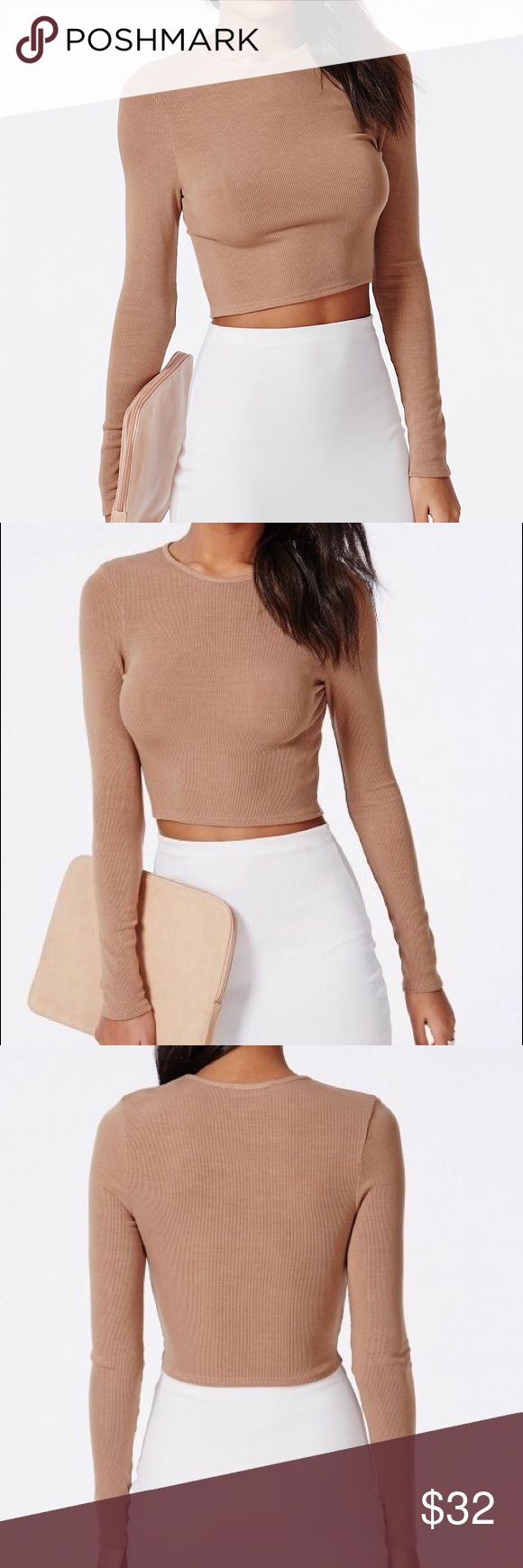 Missguided Ribbed Long Sleeve Camel Crop Top New with tags! work this 90's inspired piece into your wardrobe for a touch of urban styling. this long sleeve crop top in ribbed jersey will be your new fave go-to piece with it's versatile style and fresh camel finish. team with ripped jeans and skater pumps for a relaxed finish. Missguided Tops