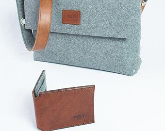 "Mens felt satchel bag handmade from 3 mm industrial wool felt, which is assembled using pop rivets. The strap is made from 100% vegetable tanned full-grain leather which is backed with wool felt and fastens onto the bag with carabiners.  The front flap fastens with a magnetic snap and there are internal pockets for your phone and wallet.  Dimensions:  Length 9 / 23cm  Width 10 / 25cm  Depth 2.5"" / 6cm  This bag, like all my items, are designed and made by myself in London, UK. I do not hold…"