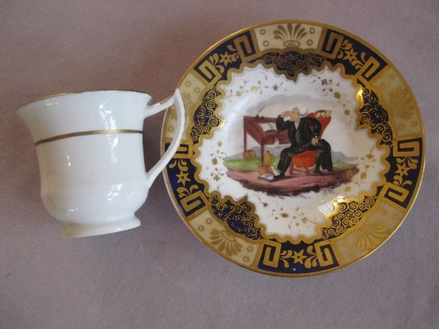 A rare C & S painted with Dr Syntax scenes... the saucer with him at his desk and the well of the cup with him walking in the country and reading a book.The borders with blue ,lemon and gilt. Figure 7 type handle Possibly Rathbone or Clews    Circa 1820