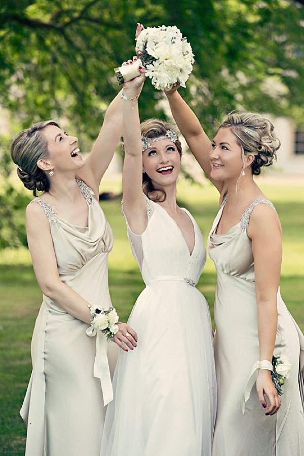 Bridesmaids in champagne cowl neck wedding dresses. Photography by…