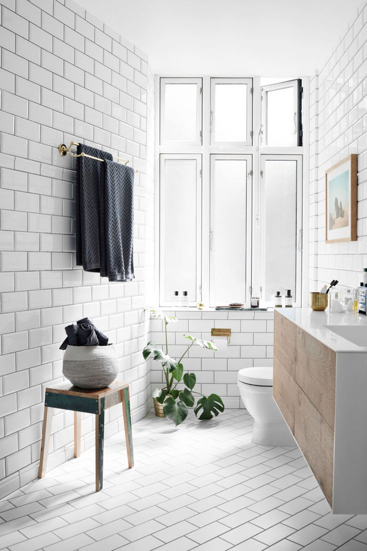 Vintage black and white bathroom ideas - Minimalist Black And White Bathroom With Floor To Ceiling Subway Tiles Floating Console Sink And