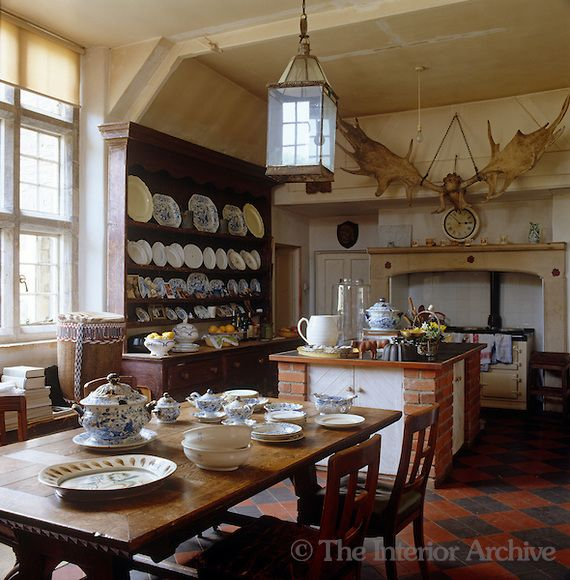 English Kitchen Design: A Large Set Of Antlers Hangs Above The Range In This Country Kitchen And The Dresser Displays A