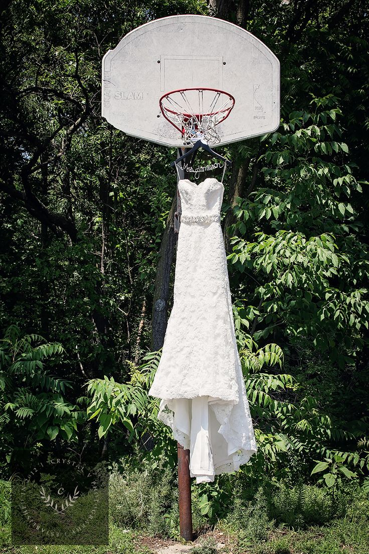 Basketball themed wedding.  Hang the dress off a basketball hoop!  Grand Rapids, MI wedding.