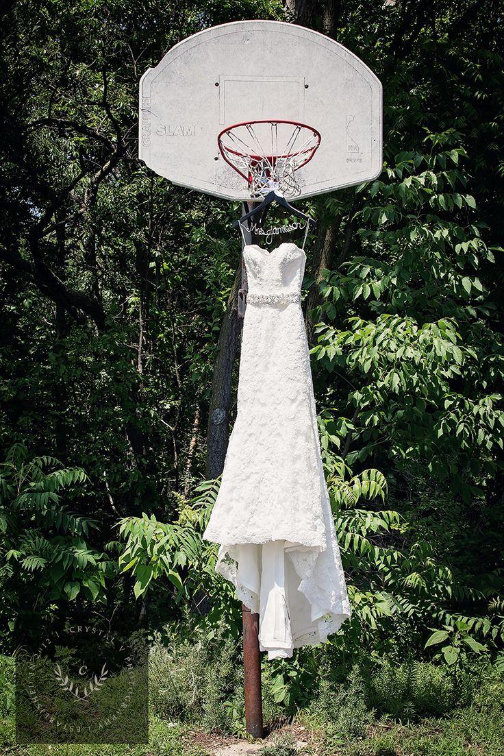 Basketball themed wedding.  Hang the dress off a basketball hoop!  Grand Rapids, MI wedding.