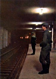 "East German Solders guarding a ""Ghost Station"" in Berlin. Since the underground train service was operated from west Berlin, it wasn't allowed to stop in the eastern sector. But of course, some lines had stops there. These were constantly guarded by VoPo's against evil capitalism...."