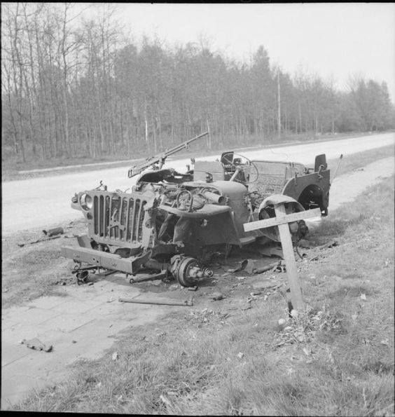 The grave of a British soldier who was killed during Operation Market Garden in 1944 lies alongside the wreckage of his jeep near Arnhem 18 April 1945.