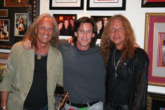 Michael Dunn, Owner of ROCK STAR gallery, Scottsdale enjoys a visit with band members of Lynryd Sknryd.