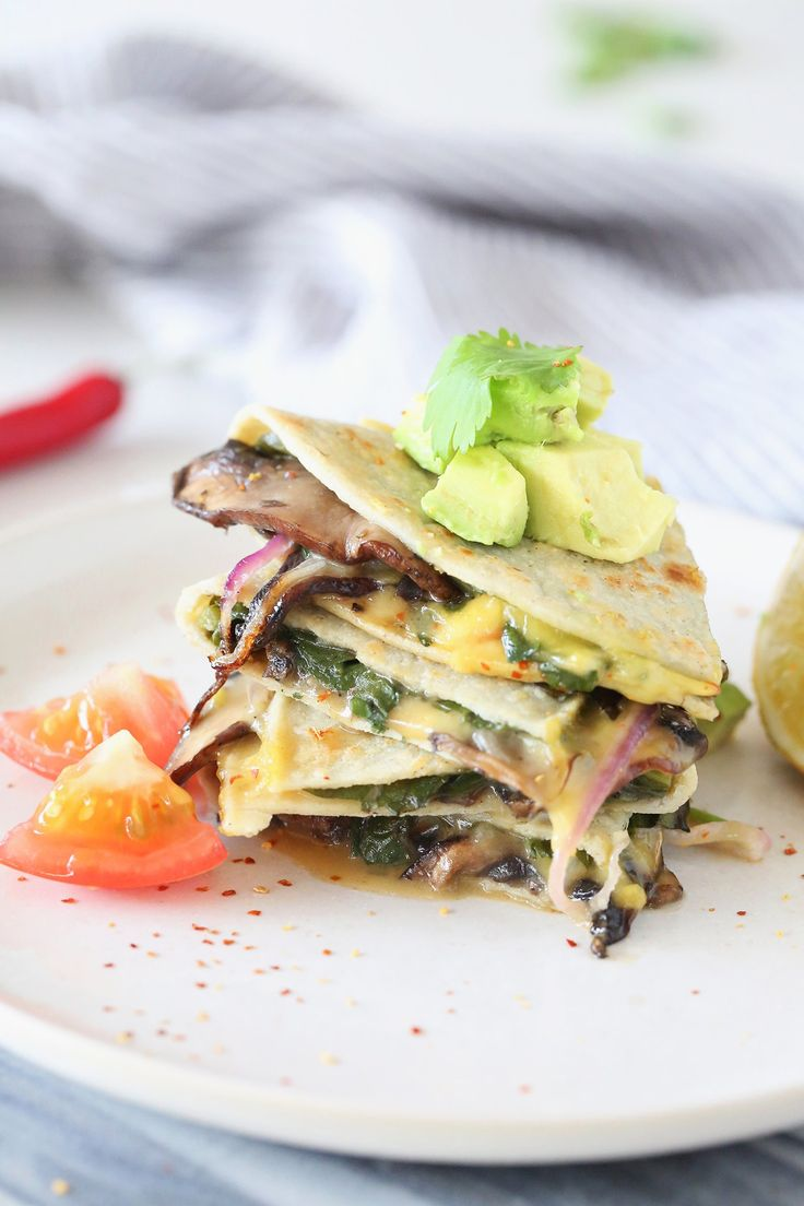 It's quesadilla time! Shake up your weekday meal routine with these pockets of goodness – filled with delicious meaty mushrooms, greens for good measure, and oozing with cheese. Vegan, dairy free, gluten free.