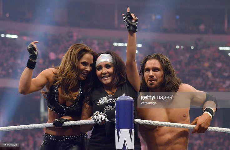 Trish Stratus, Nicole 'Snooki' Polizzi and John Morrison during WrestleMania XXVII at Georgia Dome on April 3, 2011 in Atlanta, Georgia.