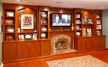Sports memorabilia shelving ~ Wall unit with TV and decorative shelving traditional family room